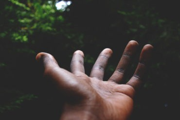 Black man's hands in the forest
