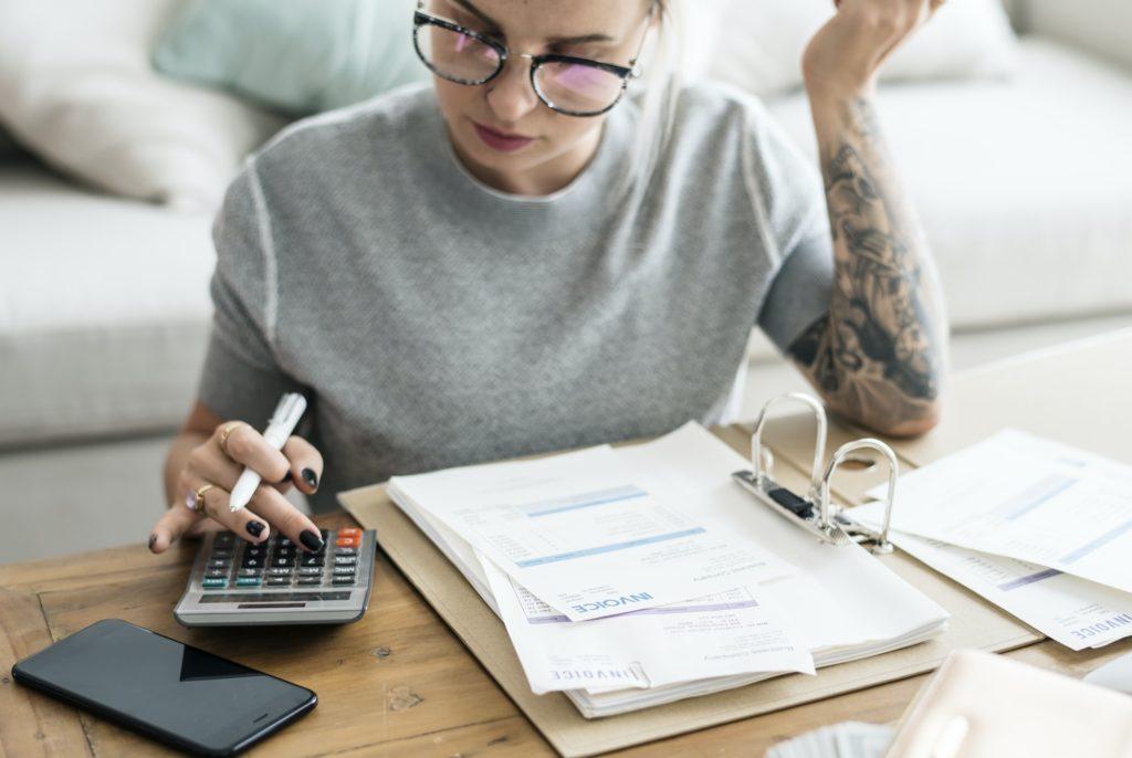 Caucasian woman with invoice bills