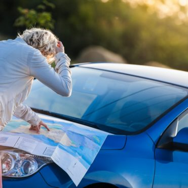 Pensive Woman on a Rural Scene Looking at a Map