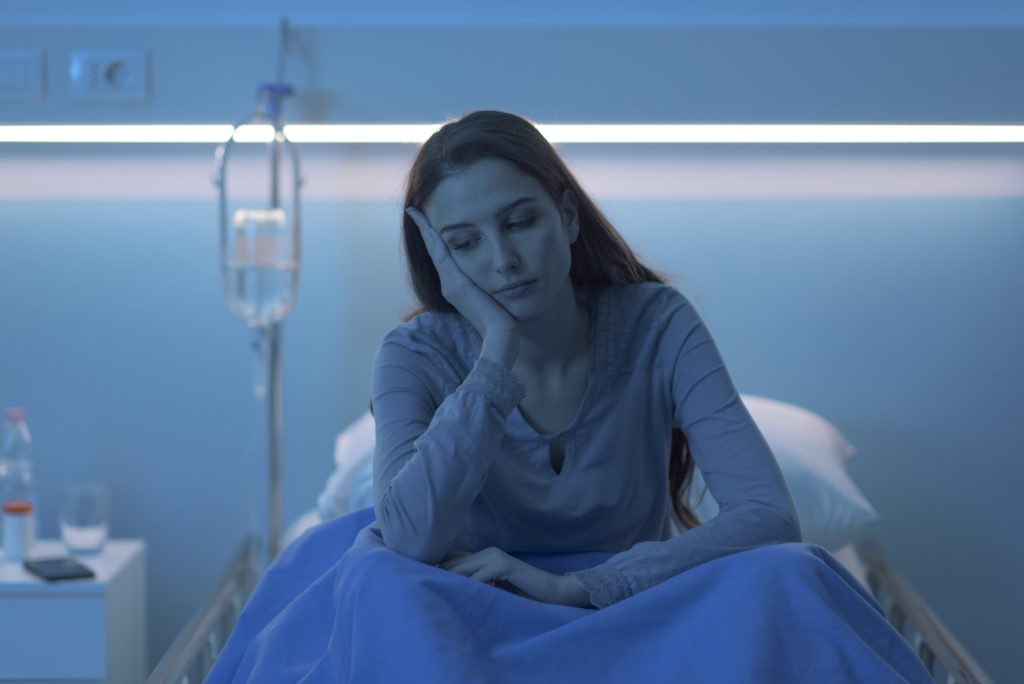 Sad lonely woman in the hospital at night