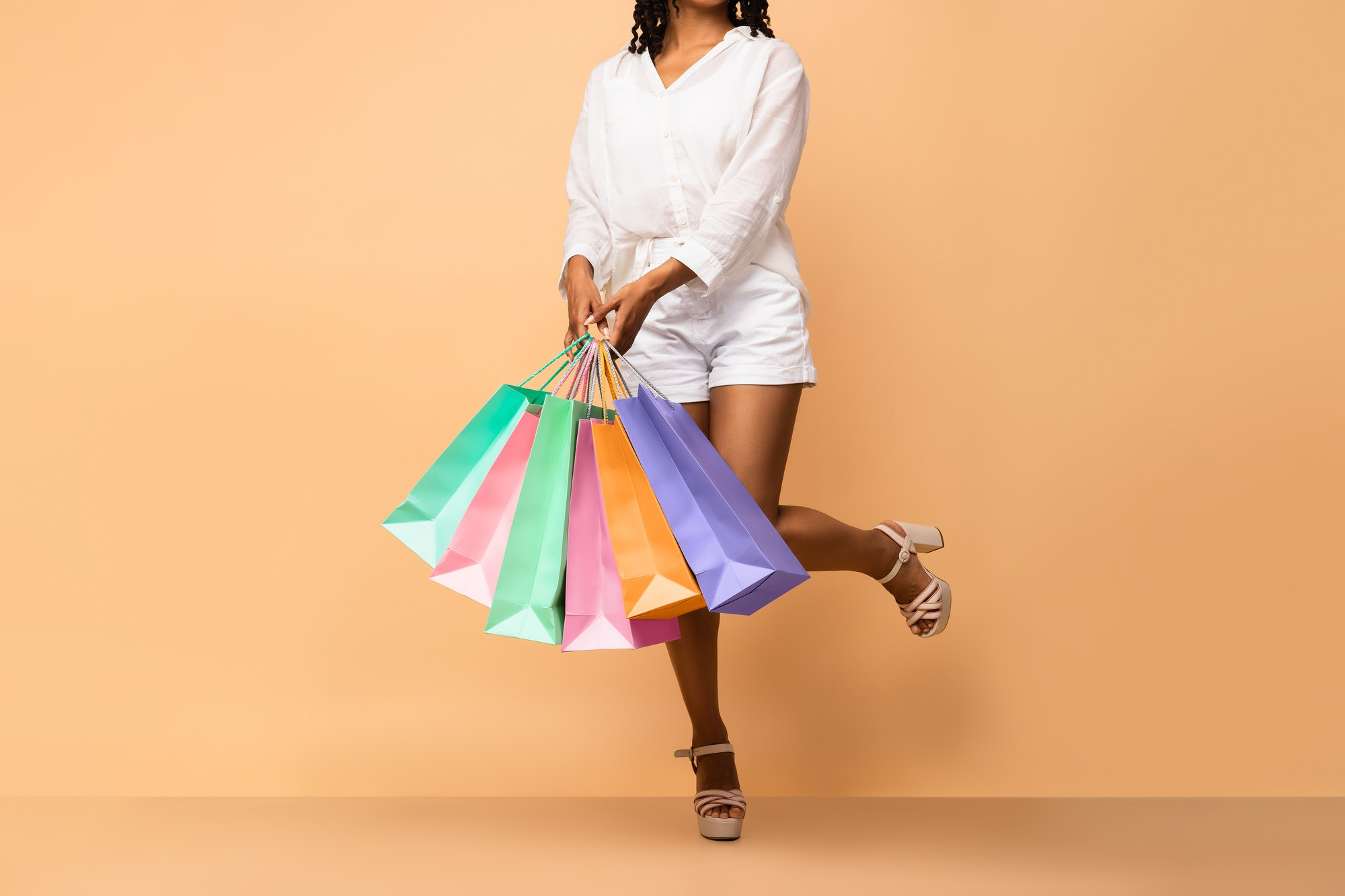 Unrecognizable Black Woman With Shopping Bags Posing In Studio, Cropped